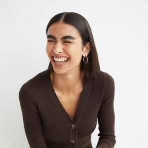 Model wears brown knit cardigan