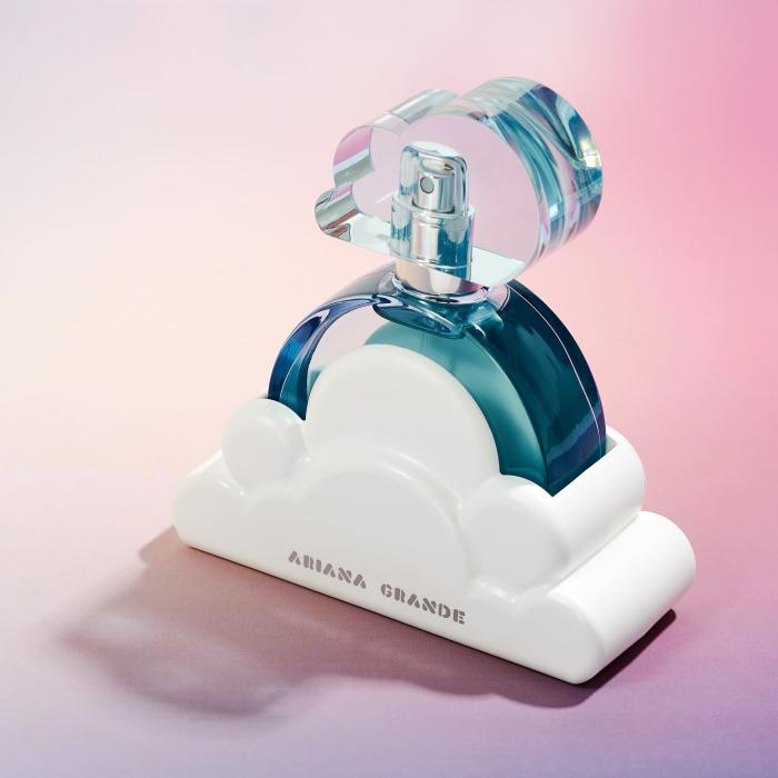 Cloud perfume bottle on a pink background`