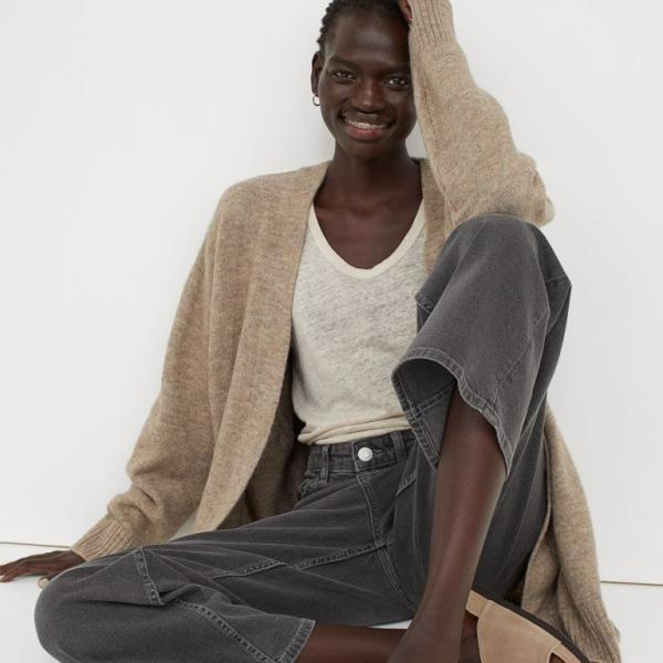 Model wearing long brown cardigan