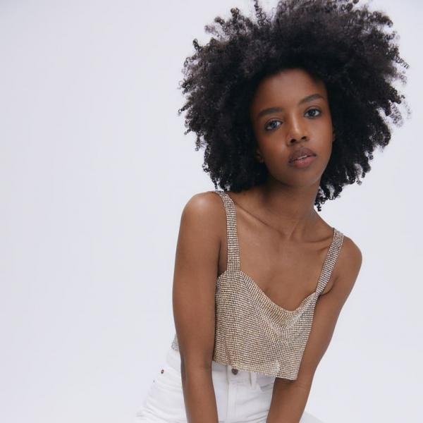 Model wears silver glitter crop top from H&M