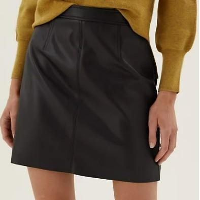 Black faux leather mini skirt worn with yellow jumper